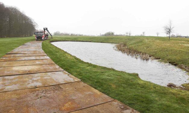 Udlægning af køreplader på golfbane